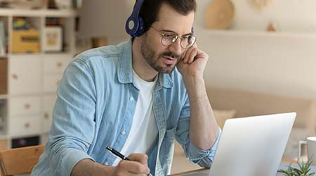 A man listening in on an online course