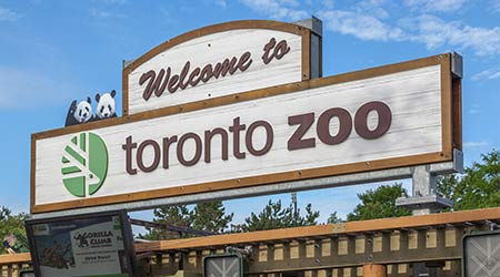 TORONTO, CANADA - JULY 31, 2016: sign of the Toronto Zoo at entrance in Toronto, Canada. Toronto Zoo is Canadian the largest zoo with over 5,000 animals.
