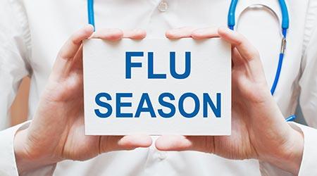 Flu Season card in hands of Medical Doctor