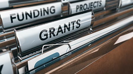 Brown folder related to funding and grants
