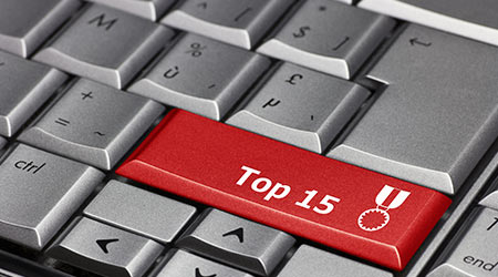 "Computer keyboard where the enter key has been replaced by ""Top 15"""