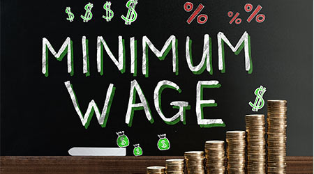 Coins stacked to symbolize a raise in minimum wage