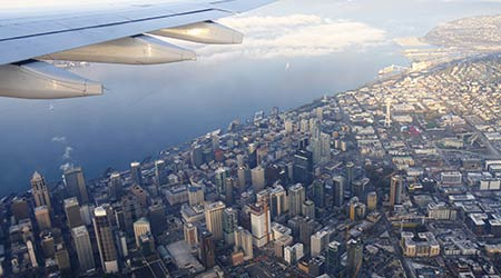 SEATTLE, WASHINGTON—MARCH 2018: Aerial view of Seattle, Washington coastline with skyscrapers before landing at the Seattle-Tacoma International Airport.
