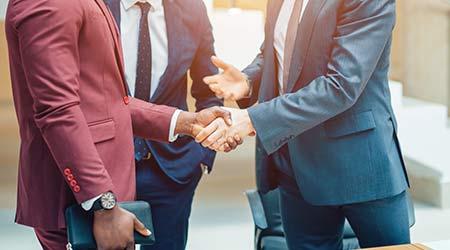 Business partnership meeting concept. Image businessman's handshake. Successful businessmen handshaking after good deal. Horizontal, blurred background