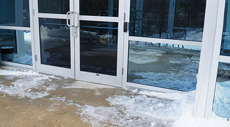 close up on office building door exterior with snow removed