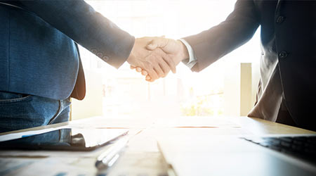 Two confident business man shaking hands during a meeting in the office, success, dealing, greeting and partner