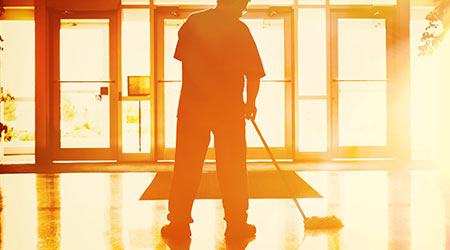 Janitor mopping in an office building
