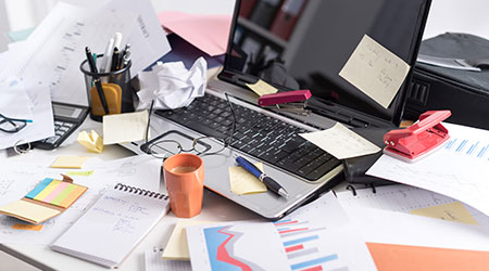 Messy and cluttered office desk