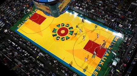 Milwaukee Bucks basketball court wood floor refinished to glossy shine