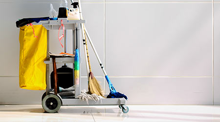 Cleaning Cart in the station.Cleaning cart with wall background