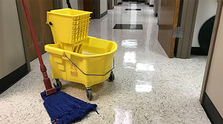 Janitors cleaning mop and bucket