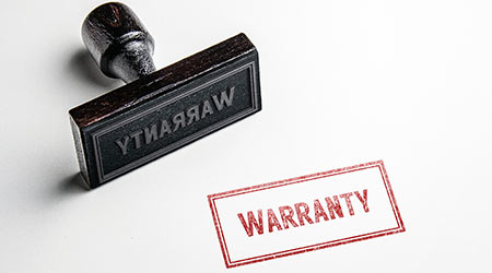 Rubber stamping that says 'Warranty'.