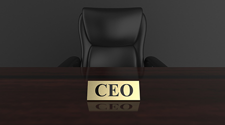 CEO nameplate on empty wooden desk
