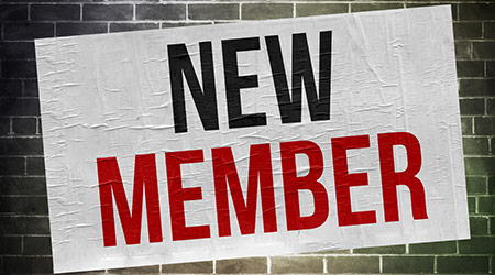 """A poster that says """"NEW MEMBER"""""""