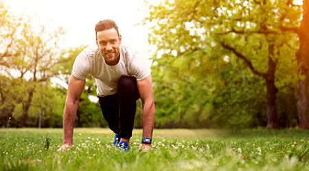 Fit man exercising in a park