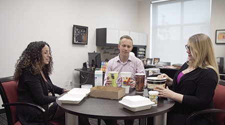Marianne Abiaad talks business with Rob Mouw and Anna Lemus