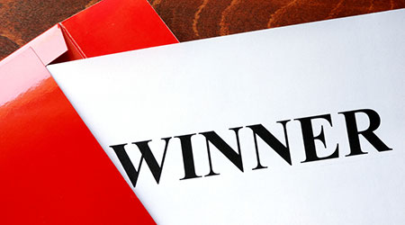 Paper with word winner and red envelope