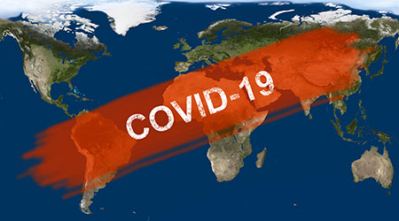 COVID-19 written across map of the world