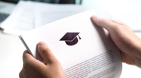College or university application or letter from school. Student or teacher reading education document. Young man holding grant, graduation, study loan or scholarship paper.