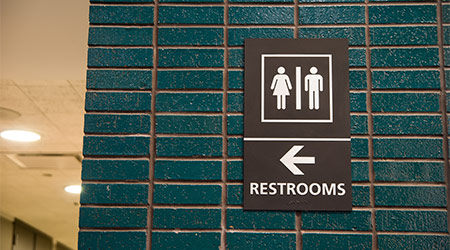 A sign pointing to public restrooms