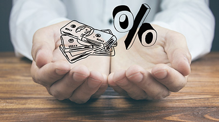a hand holding a sketch of money and a percent sign