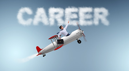 Businessman flying a small airplane upwards to symbols success