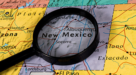 New Mexico state on the map under magnifying glass